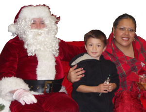 Image of child visiting Santa and Mrs. Claus.