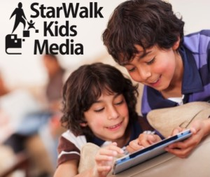 Two boys reading a StarWalk Kids book on a tablet.